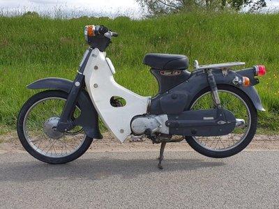 Honda C50 NT Japans, bruin, 4525 km, met kenteken